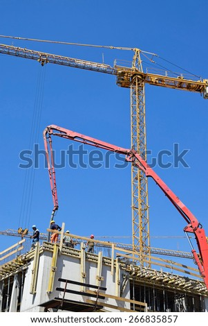 Tower crane is working at the construction of a new building