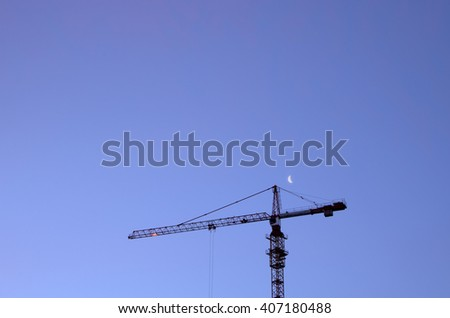 Tower crane on a background of the night sky - stock photo