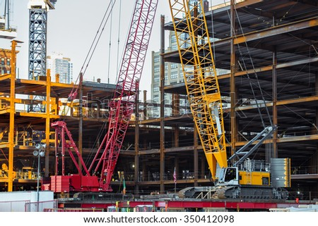 Tower cranes on the skyscraper construction in New York City - stock photo