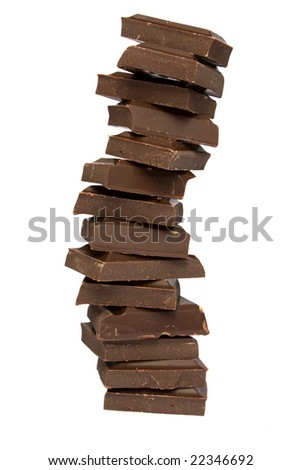 Tower from chocolate fragments on a white background it is isolated