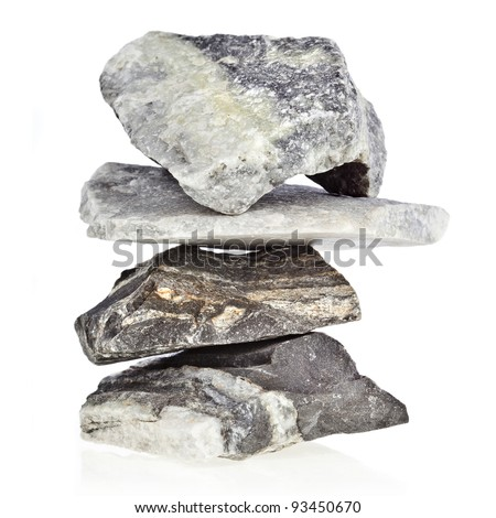 tower heap pile of natural marble stones isolated on white background