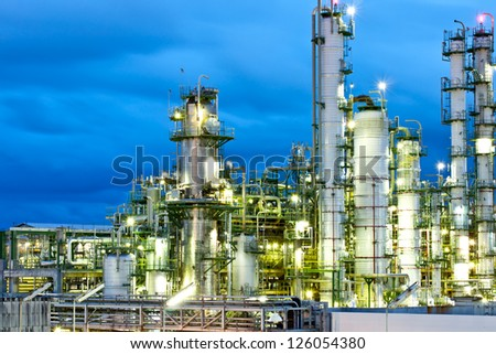 tower in petrochemical plant at night time - stock photo