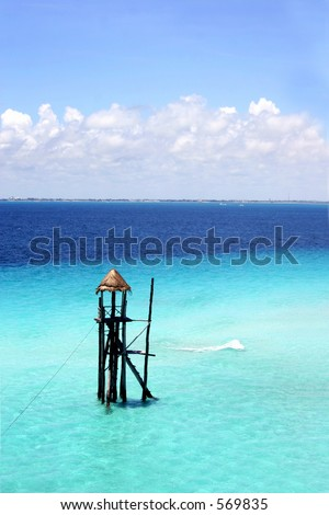 Tower in the blue sea off Isla Mujeres, Yucatan, Mexico - stock photo