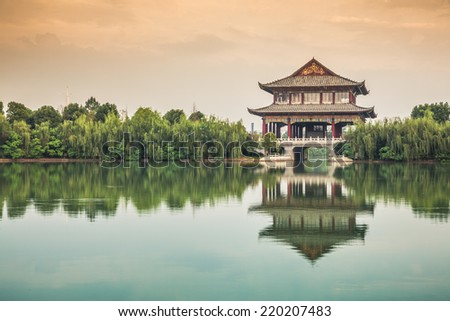 tower in the lake with reflection