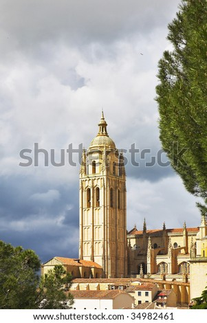 Tower of a cathedral in Segovia on a background of the cloudy sky
