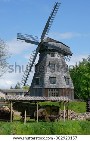 Tower of an old wooden windmill against the sky landscape