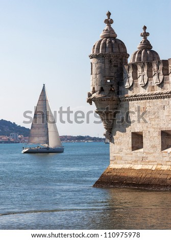 Tower of Belem ( Torre de Belem ) and white yacht - Lisbon, Portugal - stock photo