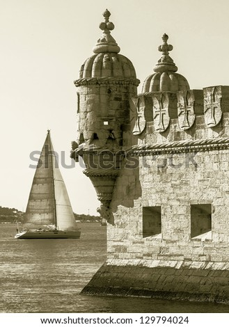 Tower of Belem ( Torre de Belem ) and white yacht - Lisbon, Portugal (stylized retro) - stock photo