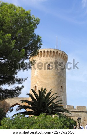 Tower of Bellver Castle, a Gothic style circular castle on a hill 3 km northwest of Palma on the Island of Majorca, Spain.  - stock photo
