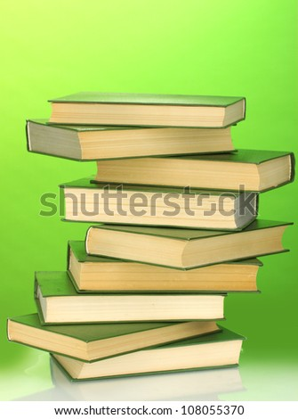 Tower of books on green background