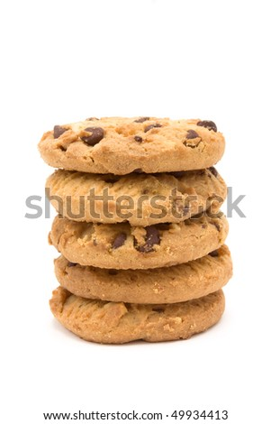 Tower of Choc Chip n Hazelnut Biscuits from low viewpoint isolated against white background. - stock photo