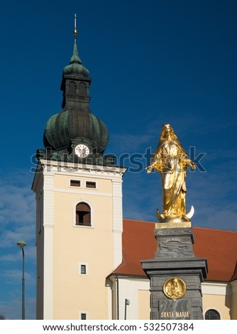 Tower of church in Kunstat town in Moravia in Czech Republic with statue
