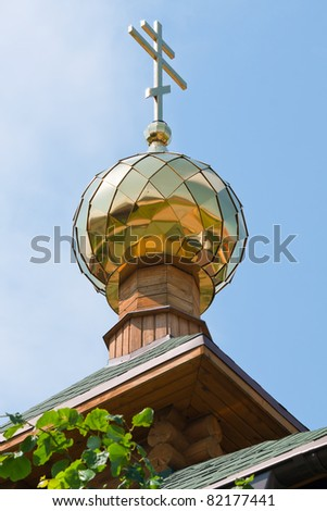 Tower of church with a dome and a cross against the sky. Large format.