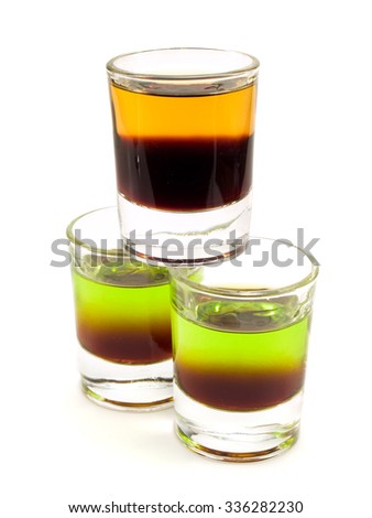 Tower of cocktail shots isolated on white background. Side view. - stock photo