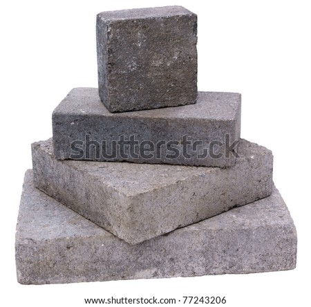 Tower of concrete construction blocks, isolated against background