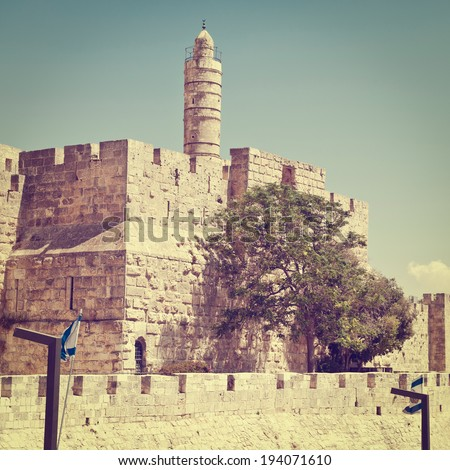 Tower of David and Ancient Walls Surrounding Old City of Jerusalem, Instagram Effect - stock photo