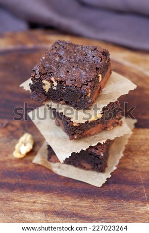 tower of delicious crusty brownies on wood background
