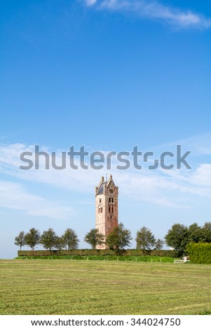 Tower of demolished church of the Frisian town of Firdgum in Friesland, Netherlands - stock photo