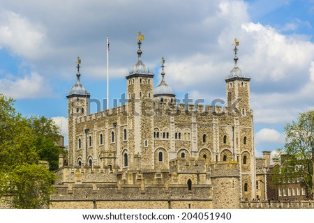 Tower of London (Her Majesty's Royal Palace and Fortress) - historic castle on the north bank of the River Thames in central London - a popular tourist attraction. View of Tower from River Thames. - stock photo