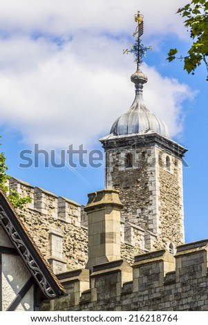 Tower of London (Her Majesty's Royal Palace and Fortress) - historic castle on the north bank of the River Thames in central London - a popular tourist attraction. View of Tower from outside walls. - stock photo