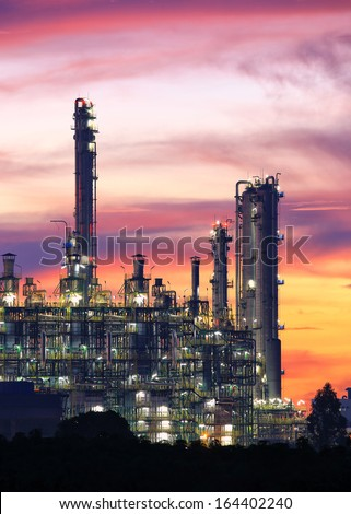 Tower of oil refinery at twilight sunrise  - stock photo