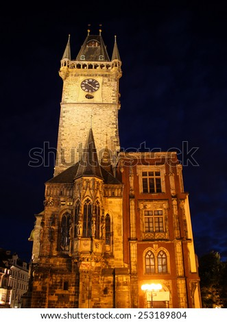 Tower of Old Town Hall in Prague, Czech Republic during night time. Famous landmark of Prague built in 14th century with Astrological clock on south side. - stock photo