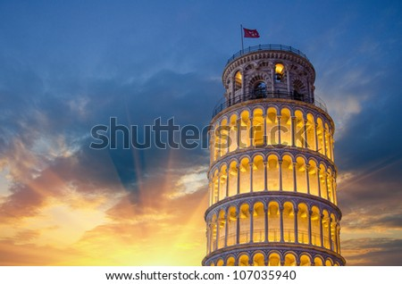 Tower of Pisa in Miracles Square, Illuminated at Night with sunset, Italy - stock photo