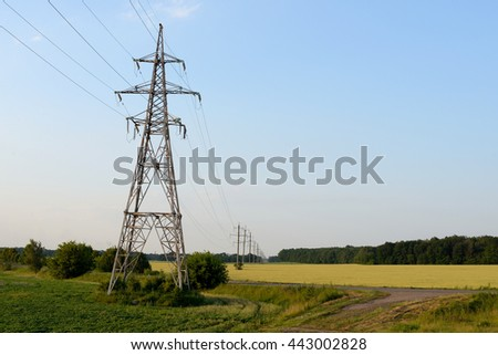 Tower of power lines on the field