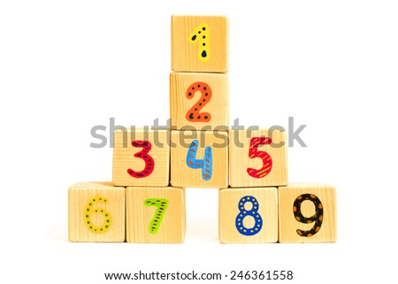 Tower of wood cubes with colored numbers