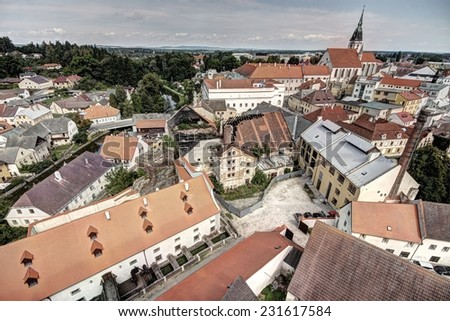Tower outlook to the buildings of the historical bohemian city center - stock photo