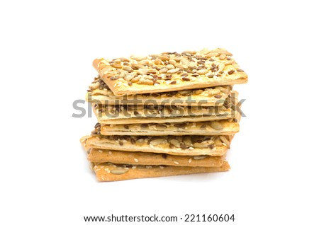 tower stack of cookies with sesame seeds isolated on a white background - stock photo