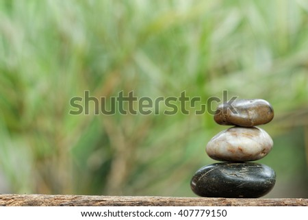Tower stone with blurred images of bamboo in the background. Concept of tranquility and relaxing. - stock photo