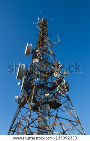 Tower telecommunications  with satellite dishes transmit and receive