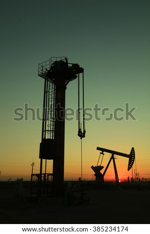 Tower type pumping unit under the setting sun in a oilfield