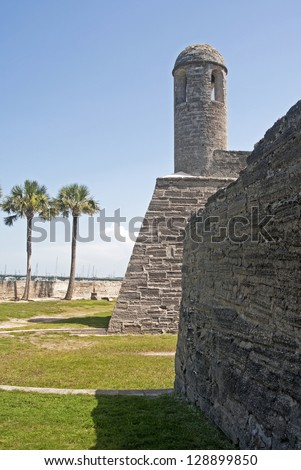Tower, walls and field of the old Castillo de San Marcos, in St. Augustine, Florida, on a sunny and overcast day. - stock photo