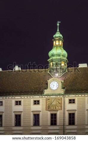 Tower with a clock above the Amalienburg in Hofburg Palace, Vienna - stock photo