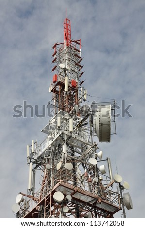 Tower with antennas, transmission systems - stock photo