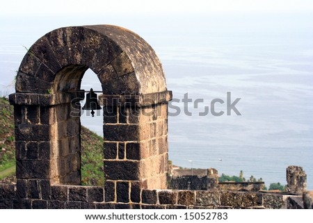 Tower with bell at Brimstone Hill Fortress, St. Kitts, West Indies.