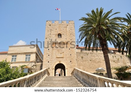 Tower with entrance staircase to the old town. Korcula, Croatia - stock photo