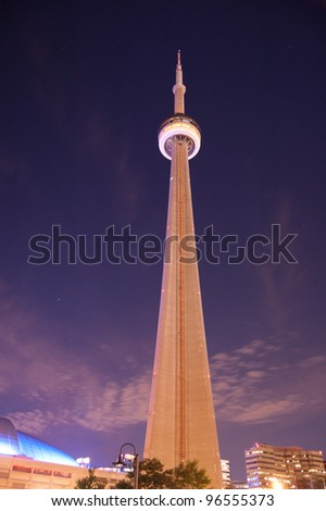 Towering CN Tower Skyscaper at night - stock photo
