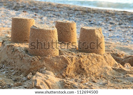 Towers from sand- castle on the beach - stock photo