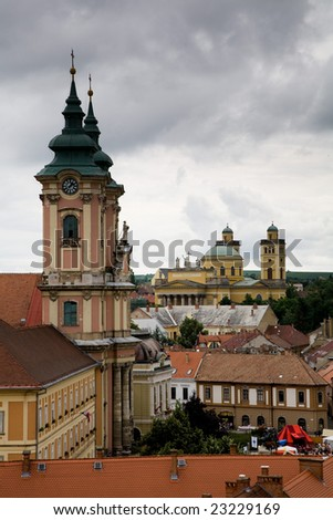 Towers of church and dome of the basilica in the Hungarian small town of Eger. - stock photo