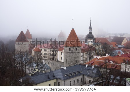 Towers of old town in Tallinn  in fog - stock photo