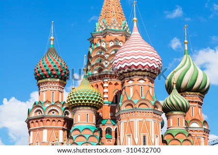 towers of Pokrovsky cathedral on Red Square in Moscow and blue sky in sunny summer day - stock photo