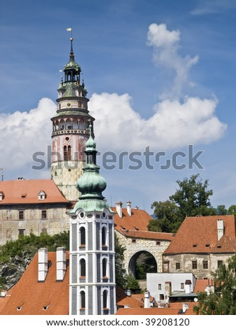 Towers of the church and castle of the town of Cesky Krumlov in the Czech Republic, on the rooftops of the city