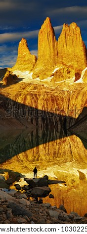 Towers with reflection at sunrise, Torres del Paine National Park, Patagonia, Chile - stock photo