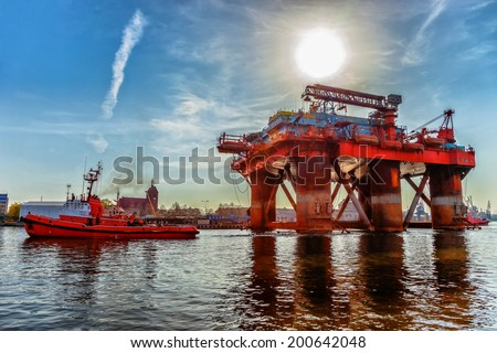 Towing Oil Rig in the Port of Gdansk, Poland. - stock photo