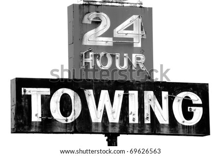 Towing sign at a repair shop along Interstate 5 in Southern Oregon - stock photo