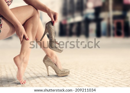 town and legs of woman  - stock photo