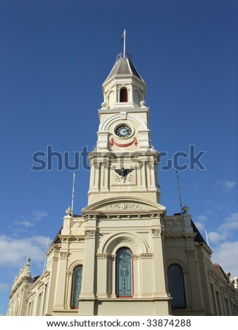 Town Hall building in fremantle against blue sky - stock photo